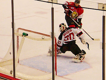 English: Puck slips Martin Brodeur for a goal....