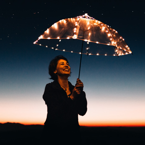 Woman holding umbrella with leds