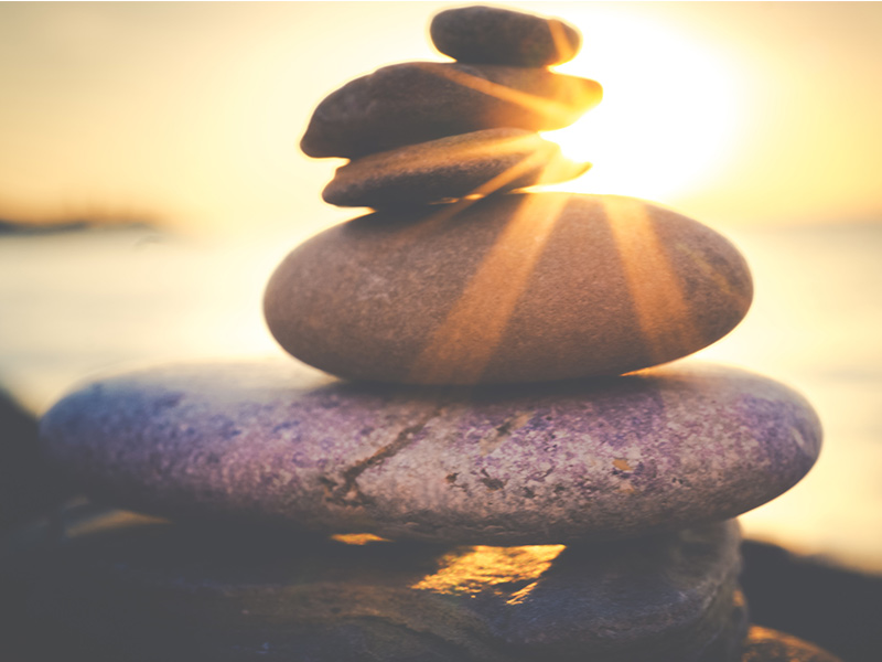Photo Of Rock Stacked With Sunset Behind