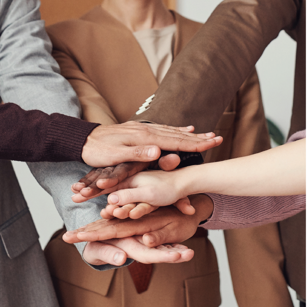 close up of hands in with people in suits