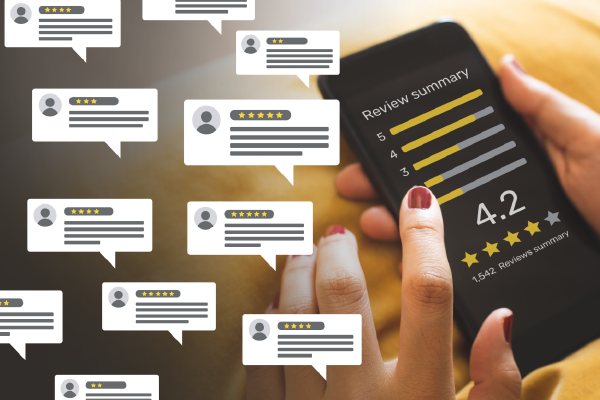 A Person Touching A Mobile Device With An Online Review Displayed With 4.2 Stars And An Overlay Of Several Nondescript Word Bubbles Representing Reviews