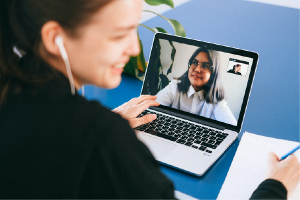 Two Individuals On Video Chat Both Smiling