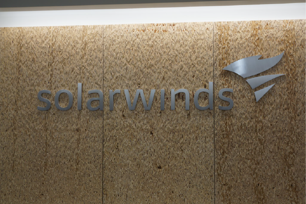 """A Sign For Solarwinds On A Light Brown Wall. """"SolarWinds Sign"""" By Sfoskett Is Licensed Under CC BY-NC-SA 2.0"""