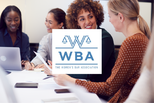 An Image Of Women At A Table Talking With The Logo Of The Women's Bar Association Layered In The Center