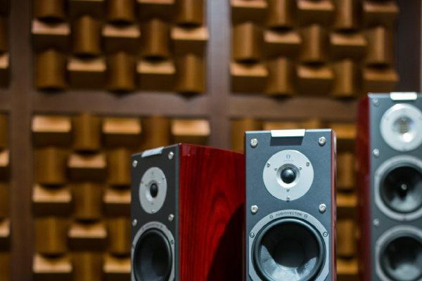 An Image Of Three Large Speakers With A Sound Absorbing Wall In The Background