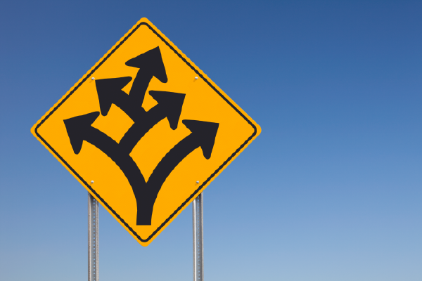 An Image Of A Traffic Sign Showing A Fork, With Another Fork Extending From One Side, And Another Fork Extending From One Side On The Second Fork, Showing Three In Total, With A Blue Sky In The Background