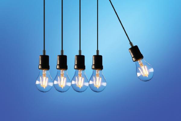 An Image Of Lightbulbs Arranged In A Newton's Cradle