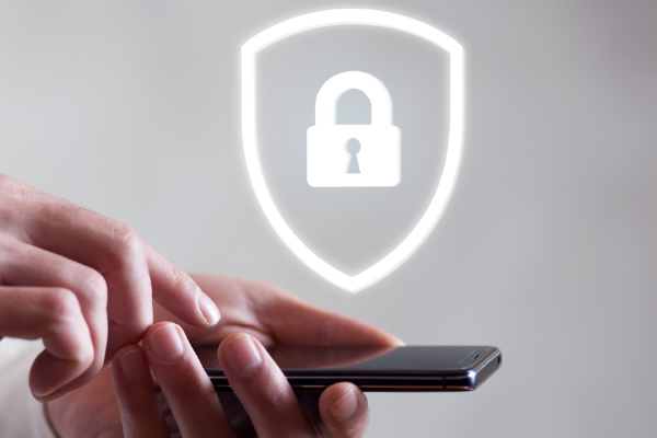 An Image Of A Person's Hands Holding A Smart Phone With An Overlay Of A Graphic Of A Lock Positioned Above It